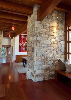Stone wall brings a touch of rustic charm to the interior - Decoist