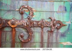 Rusty hinge on wooden door by Volfoni, via Shutterstock