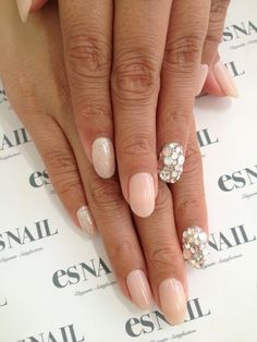 I love the embellished ring finger nail trend!