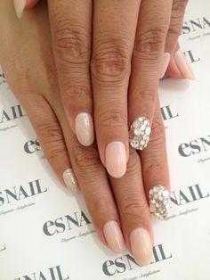 I love the embellished ring finger nail trend!