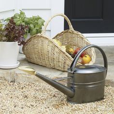 A British favorite for years, the highly efficient, utilitarian-chic Haws watering can features an ultra-slim oval shape, rust-resistant galvanized steel construction and lasting titanium powdercoat finish. Sturdy one-piece handle is makes it easy to balance and adjust your grip. All-brass watering rose can be turned up for seedlings and smaller plants, down for heavier watering or removed entirely for trees, large pots and stronger plants.