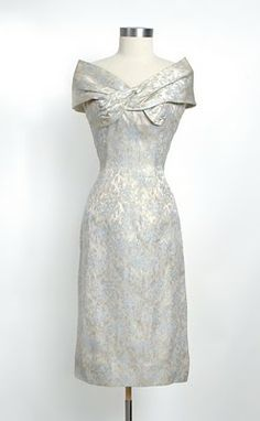 1950's+Saks+Fifth+Avenue+iridescent+brocade+cocktail+dress+with+draped+off-the-shoulder+neckline.jpg (247×400)