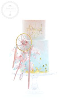 Boho chick birthday cake featuring watercolour finish, a dreamcatcher and wafer paper feathers