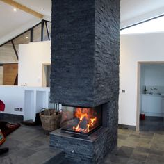 chimney log burner fireplace in middle of open plan room - Google Search