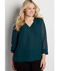 the perfect plus size blouse with shimmering dots and solid hem