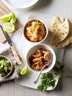 Soft prawn tacos with coleslaw, avocado and coriander