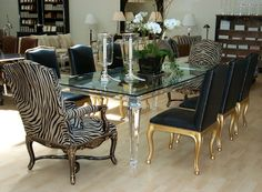 Pacific Heights Place Showroom with Acrylic Dining Table W96 D48 H30, with Ralph Lauren Duke Dining Side Chairs in distressed black leather and antique gold finish  http://www.pacificheightsplace.com/#!product/prd15/3253656901/acrylic-dining-table