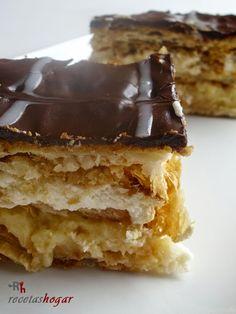 Milhoja de crema pastelera, nata y chocolate.Un postre fácil, rápido y sencillo. Explicada paso a paso con fotos en cada uno de ellos.