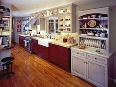 Red Cabinets with contrasting cream.....I'm doing my kitchen something like this...I will have a small cream hutch w/red beadboard in back... One Wall Kitchen, Two Tone Kitchen Cabinets, Kitchen Cabinet Styles, Red Cabinets, Glass Cabinets, Upper Cabinets, Island Kitchen, Kitchen Backsplash, Updating Cabinets
