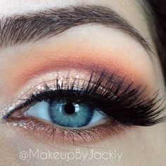 This look blends an assortment of orange and golds for a brightened smokey eye. This is the perfect palette for a stunning autumn look...x
