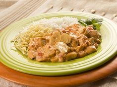 Strogonoff. Dish can be made with chicken, beef or prawns. The meat is cooked with tomato sauce and double cream. Served with rice and deep-fried finally grated potatoes.