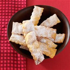"""Italian Cenci Cookies Recipe -My mother brought this special family recipe from Europe a century ago. Cenci can be """"dressed up"""" for any holiday—at Easter, I sprinkle yellow, pink and lavender jelly beans over them, and for Christmas, red and green candy sprinkles give the cenci a festive look. Even without the garnish, they always disappear fast! —Anna Coduto, Fullerton, California"""