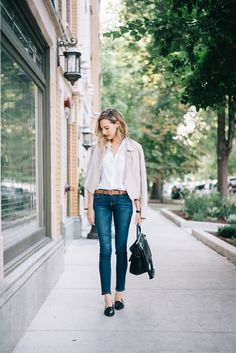 White short-sleeved button-up blouse (tucked in), dark denim cropped skinny jeans, nude leather jacket, black pointy toe loafers