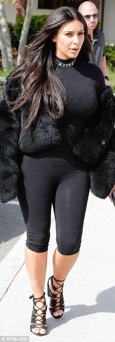Kim Kardashian wears tight bodysuit while Kourtney wears leather leggings   Daily Mail Online