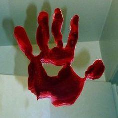 DIY bloody handprint window cling on mirror, photo by Kylyssa Shay