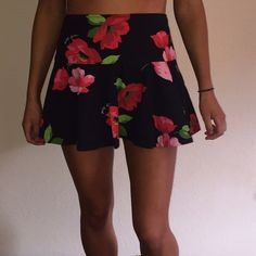 Super cute floral skirt Really dark navy skirt with red and pink and green floral! I love this skirt but it's just a tiny bit too big for me. Should fit a size 26, possibly a little bigger or smaller. Gilly Hicks Skirts A-Line or Full