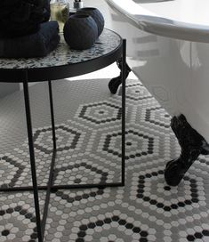 Use inserts of different colours or patterned mosaics within the plainer field mosaics on the floor to create a rug effect. This is very effective, even in bathrooms, and particularly well suited for creating a vintage-inspired bathroom where a highly patterned floor is a key element in the design. #bathroom #featurefloor #trendingdesign #monochromaticbathroom #vintageromance #mosaics #tiles Feature Walls, Vintage Romance, Floor Patterns, Design Bathroom, Trendy Home, Mosaics, Design Trends, Different Colors, Floors