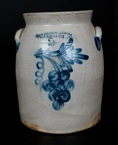 "Sold $850 Two-Gallon Stoneware Jar with Cobalt Grapes Decoration, Stamped ""COWDEN & WILCOX / HARRISBURG, PA,"" circa 1865, cylindrical jar with tooled shoulder, flared rim, and applied lug handles, decorated with a brushed cluster of eight grapes hanging from a branch with leaf and corkscrewing vine. Provenance: A fresh-to-the-market example, purchased twenty or thirty years ago in the New York State area. Chipping to rim. Wear to inner rim. Some light wear to handles and surface of jar."