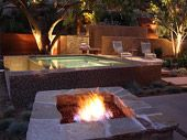 Outdoor ideas--fire pit and hot tub, lovely lighting.