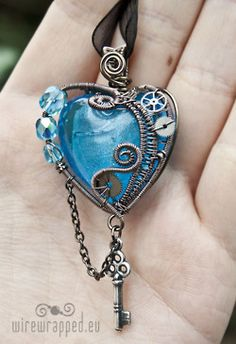 wire-wrapped heart stone with coils and crystal beads for necklace