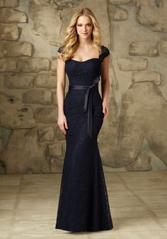 Lace Bridesmaid Dress With Satin Tie Sash and Cap Sleeves Designed by Madeline Gardner. Includes Satin Tie Sash. Shown in Navy.