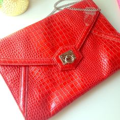 WHBM Embossed Enveloped Bag Gorgeous Red Envelope clutch with embossed print. Silver hardware. Hidden chain. Inside zip pokers with quality lining. Great clutch! Used once, like new! White House Black Market Bags