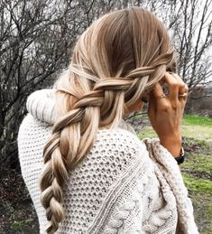 Long side braid for long hair. Beauty and hair trends for winter.