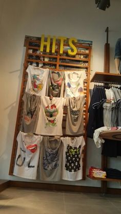 Ltb store's HITS wall and graphic t-shirts. Interior Shop, Shop Interiors, Visual Merchandising, Ladder Decor, Window, Display, Holiday Decor, Store, Wall
