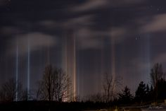 """An example of """"light pillars"""" created by the reflection of light from ice crystals in the atmosphere."""