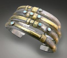 Stacking cuffs | Patricia McCleery.  Sterling silver, 22k gold and opals.