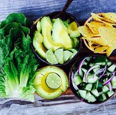 """Simple deliciousness .. Homemade healthy """"nachos"""" with organic corn chips, cos, smashed avocado with lime, red onion, cucumber and homemade tomato salsa"""