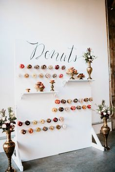 DIY wedding calls for a DIY donut wall!! Not only do they look great, 15 dozen donuts was only $150.