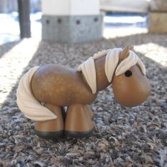 Dapple Palomino painted clay horse via Etsy