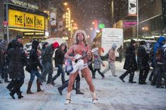 Robert Burck also known as the original 'Naked Cowboy', performs in a snow storm on the streets of Times Square, New York on Jan. 21. A winter storm packing snow and Arctic cold slammed the northeastern United States on Tuesday. Darren Ornitz / Reuters