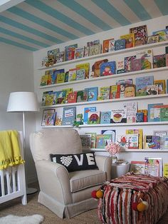 This is a GREAT Babies room! Also, I believe, my cousin did her babies room off of this bc she has books just like this and she even did stripes on  her ceilings except hers are a deep yellow... (similar to the blanket on the bed) The rest of babies room is black/white!! I love this design...