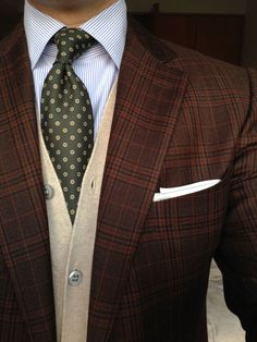 Brown Prince of Wales suit, cream cardigan, sky blue pinstripe dress shirt, dark green polka dots tie, white pocket square