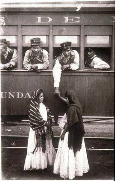 Mexico, Revolution. Revolutionary soldier aboard a train holding the hand of a woman on the ground. Photo by Agustín Victor Casasola (1874-1938). Cf. http://content.cdlib.org/ark:/13030/hb8c601174/?layout=metadata&brand=calisphere