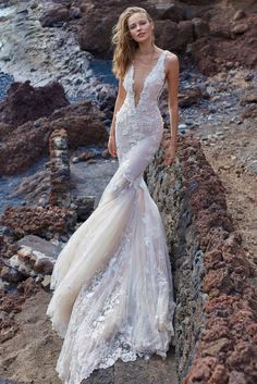 A closer look at the stunning #GALA1001 wedding dress from GALA Collection No.5. Just look how dreamy this 3D lace mermaid dress is with its deep plunging v neckline - can you see yourself wearing this gorgeous dress on your wedding day?   #GALANo5#GALAbyGaliaLahav#WeddingDress