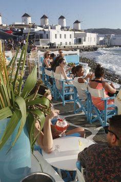 The Windmills of Mykonos, Little Venice Mykonos, Flower Inspiration, Summertime #capriceofmykonos #capricebarmykonos #greekinterior #aegeaninterior #summerdecor #aegean #greeceaesthetic #traveldestinations #visitmykonos #mykonosbar Rice Bar, Windmills, Cool Bars, Mykonos, Venice, Summertime, Travel Destinations, Greece, Good Things