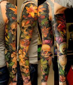 Many Flowers and Many Sculls tattoo sleeve
