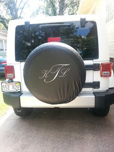 Monogrammed Jeep tire cover.