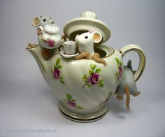 Teapot Mice by QuernusCrafts, via Flickr : mice in polymer clay, the rest a real teapot and miniature tea set.