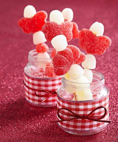 For a sweet Valentine's presentation, wrap small jars with wide ribbon and hold in place with a cord bow. Fill with skewered gumdrops or your favorite treats. More Valentine's ideas: http://www.midwestliving.com/homes/seasonal-decorating/easy-valentines-day-decorations-and-gifts/?page=10 #valentines #valentinesday
