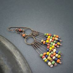 rustic earrings • oxidized copper • tribal • ethnic jewelry • Indonesian glass beads • fringes • cascade • multicolor earrings • entre2et7