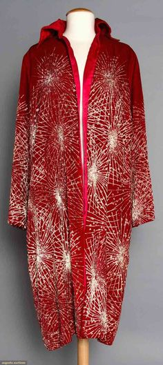 "RED VELVET OPERA COAT, 1920s  Painted w/ irridescent gold starburst pattern, tubular long sleeves, ""Ann Waller Farrell Newport, Rhode Island & Miami Beach Florida"" label, cherry red silk lining, L 42.5"", (some paint worn off, collar needs stitching in spots) very good."