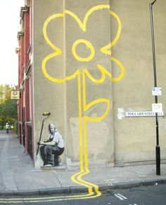 Banksy yellow flower on wall and street Is Banksy cool for kids?