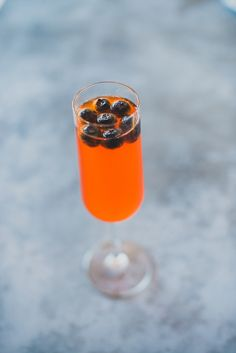 cocktail with blueberries, photo by Julie Shuford Photography http://ruffledblog.com/tropical-malibu-inspiration #wedding #drinks