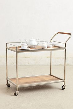 Wooden Bar Cart #anthropologie Love a bar cart ! Although mine would have the fixings for a cocktail, not tea on it !!
