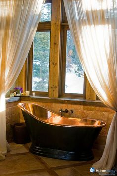 Isn't this bathtub...spectacular? Vacation home in Big Sky