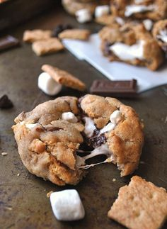 S'Mores Stuffed Cookies Recipe - A Cookie Named Desire.   I'm happy to say I had the pleasure of tasting these cookies, and they are delicious!  The blog post has great tips on how to help the marshmallow hold up during baking!